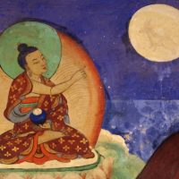Buddha pointing finger at the Moon